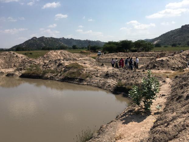 Rain-fed farm pond supplying irrigation in drought stricken region