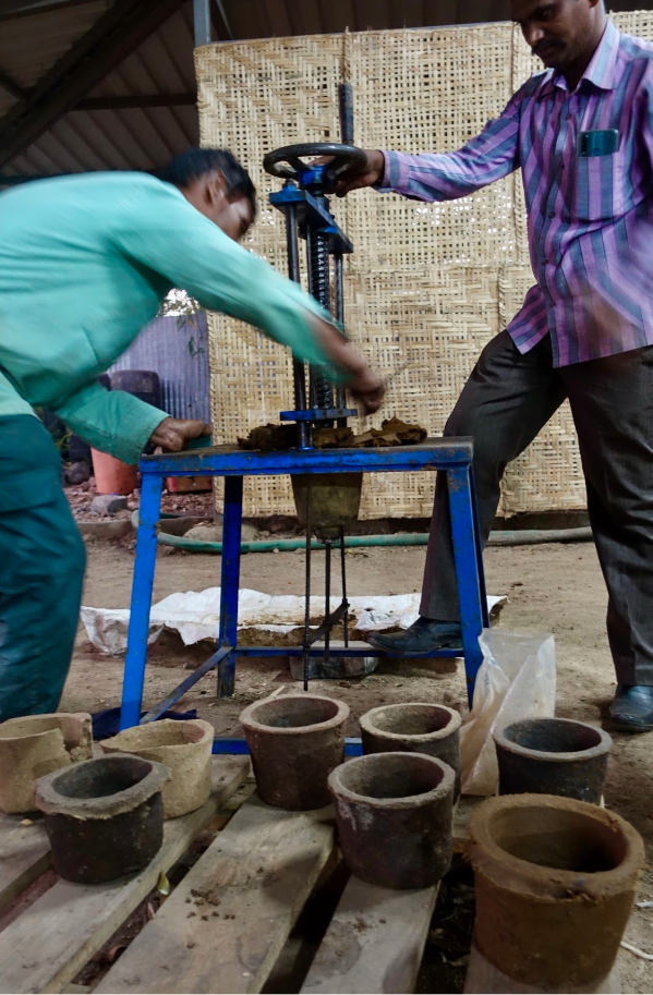 Making cow dung planting pots at the Eco Factory Foundation's waste management demonstration park.